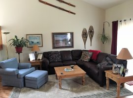 Living Room with Leather Sectional, Fire Place, Hardwood Floors