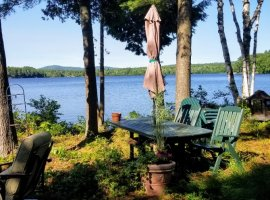 WATERS EDGE CABINS SHARE 2 WOODED ACRES ON LITTLE WOLF LAKE- 240 FT OF SANDY SHORELINE